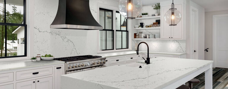 Kitchen with white, gray, and black color scheme and light countertops