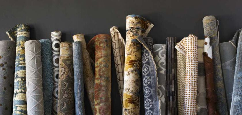 Various area rugs rolled up showing wide range of selection at NFM