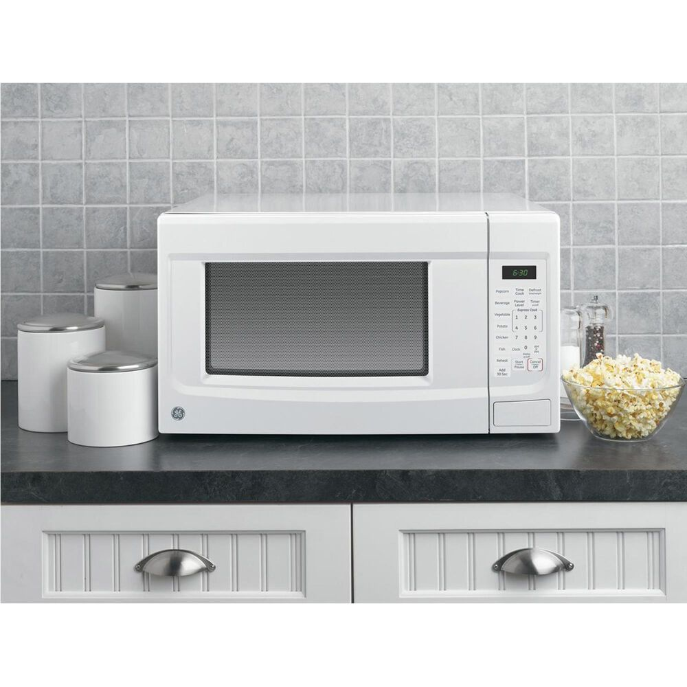 GE Appliances 1.4 Cu. Ft. Countertop Microwave Oven with 1100 Watts in White, White, large