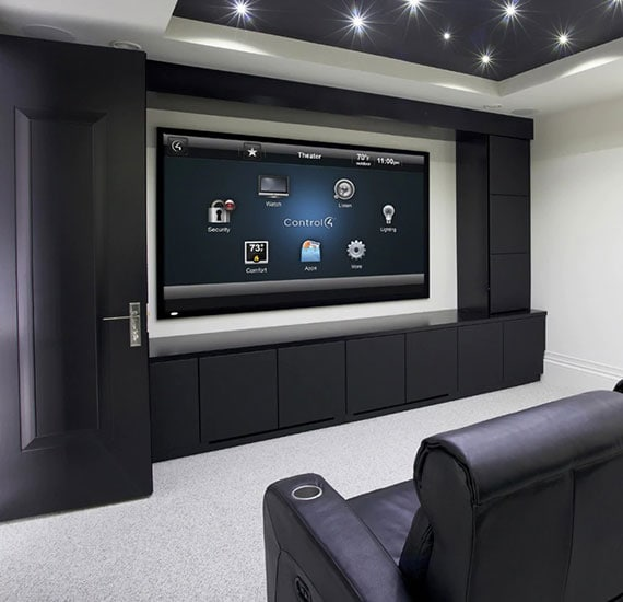 Home theater with smart home services displayed on screen.