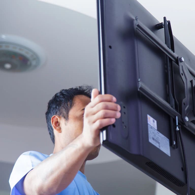 TV being mounted in home
